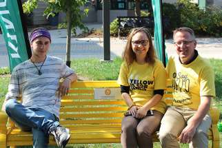 Violette Khammad, president of King's student council, and Dean of Students Joe Henry sit on the school's Friendship Bench. The Friendship Bench program started in 2014 and benches have been installed in 35 locations across Canada.