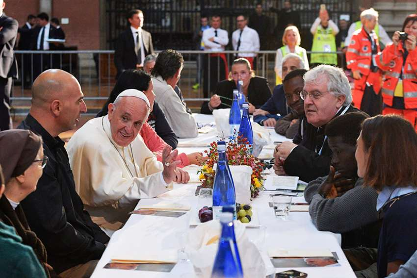 Pope Francis eats lunch with the poor, refugees and detainees in the Basilica of San Petronio in Bologna, Italy, Oct. 1.