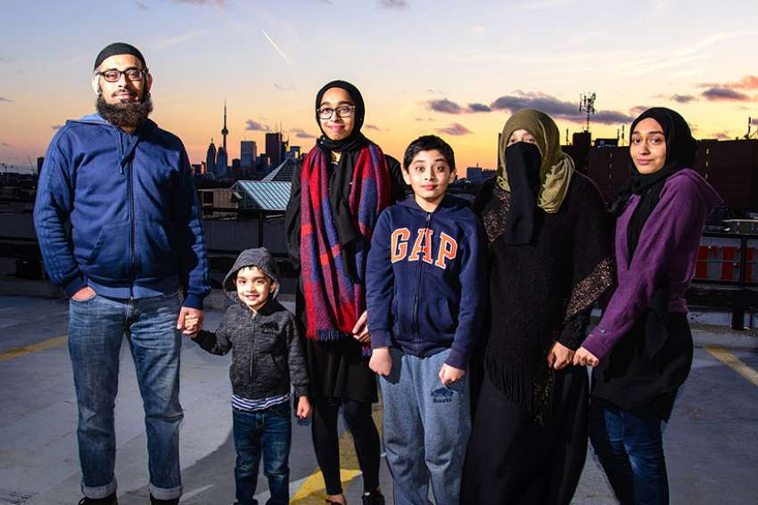 Toronto-born Sumaiya Desai, second from the right, is hoping people can get past the niqab she wears and realize that Muslims are not bad. From left to right: Yunis, Mohammed, Habeebah, Bilal, Sumaiya and Faizah.