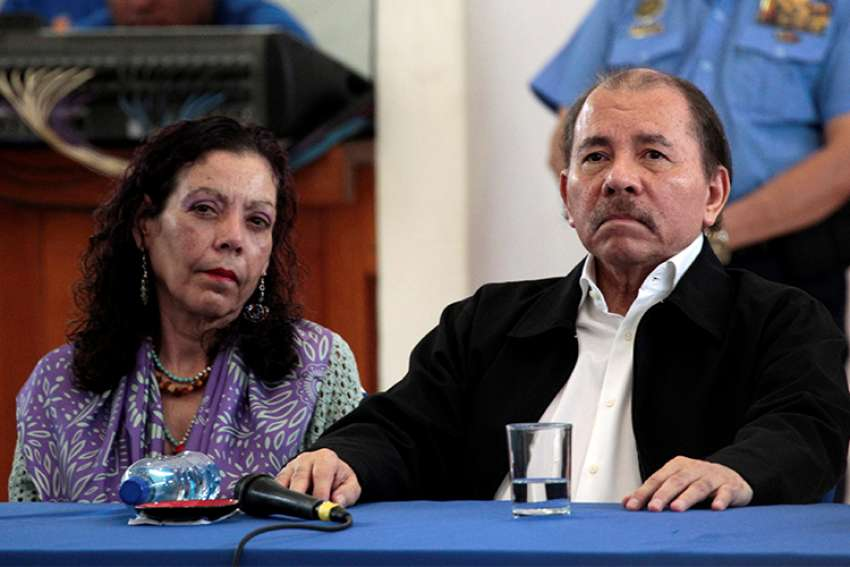 Nicaraguan President Daniel Ortega and his wife, Vice President Rosario Murillo, attend a church-mediated dialogue session in Managua May 16.