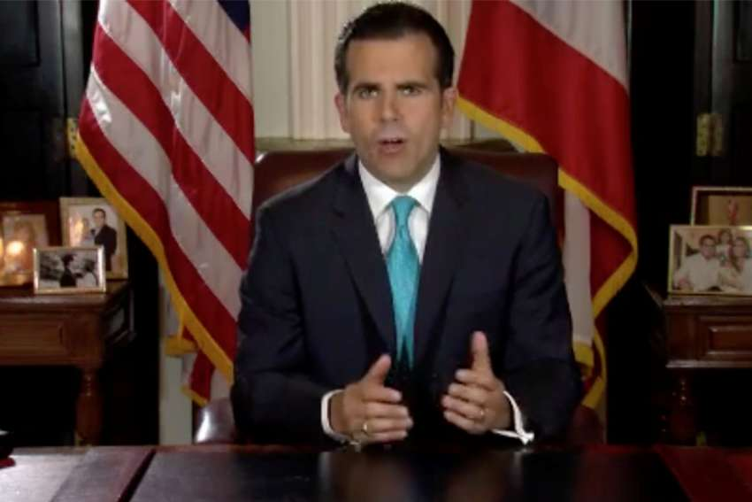 Puerto Rican Gov. Ricardo Rossello announces his resignation in San Juan late July 24, 2019. Rossello resigned amid a torrent of protests over vulgar, mean-spirited texting conversations recently made public across the island.