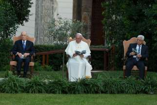 Israeli President Shimon Peres, Pope Francis and Palestinian President Mahmoud Abbas attend an invocation for peace in the Vatican Gardens June 8, 2014.