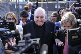 Archbishop Philip Wilson of Adelaide, Australia, leaves the courtroom after his May 22 conviction in covering up clergy sexual abuse. He was sentenced to one year detention on July 3.es next steps.