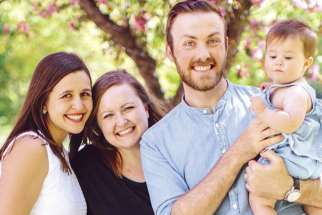 Megan Turland, left, with fellow blogger Laura- Anne Smid, husband Ben and her daughter.