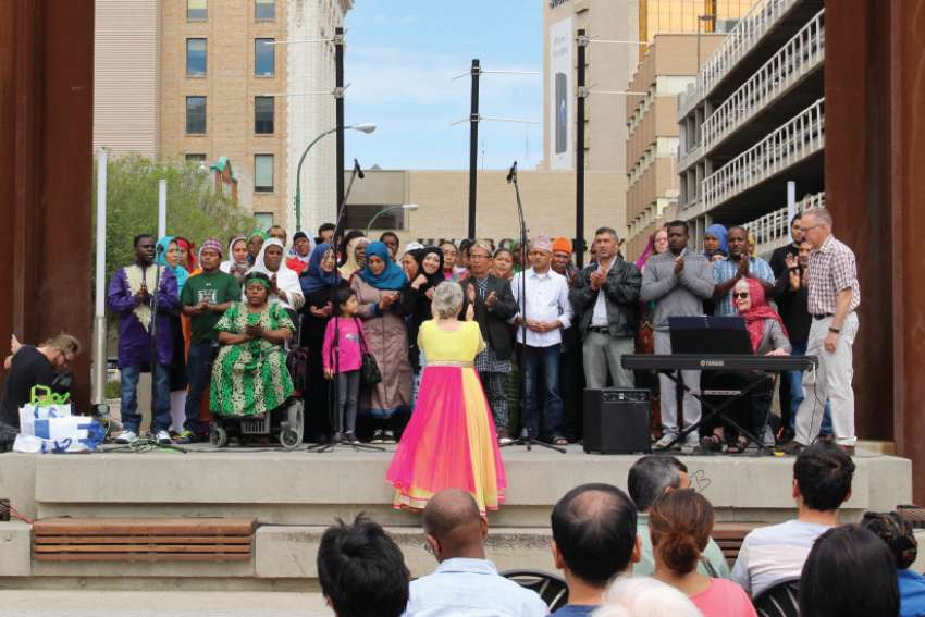 The Regina Open Door Society choir performs during World Refugee Day last June. Campion College is representative of the city's diversity with 14 per cent of its students coming from outside Canada.