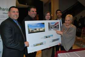 Toronto Catholic school board trustees Frank D'Amico, Sal Piccininni, Ann Andrachuk, then education director Bruce Rodrigues and area trustee Maria Rizzo pose with the plans for the proposed joint Dante Alighieri school and community centre in this 2012 photo.