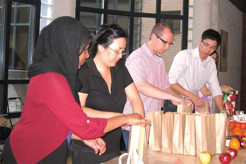 A past Muslim-Catholic Student Dialogue group preparing sandwiches to give to the homeless.