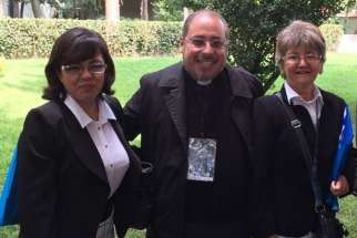 Father Ruben Alcantara Diaz, pastor of Our Lady of Carmen Parish in Cuautitlan Izcalli, Mexico, was stabbed to death in his parish April 18. He is pictured with two unidentified women in 2015 in Mexico City.