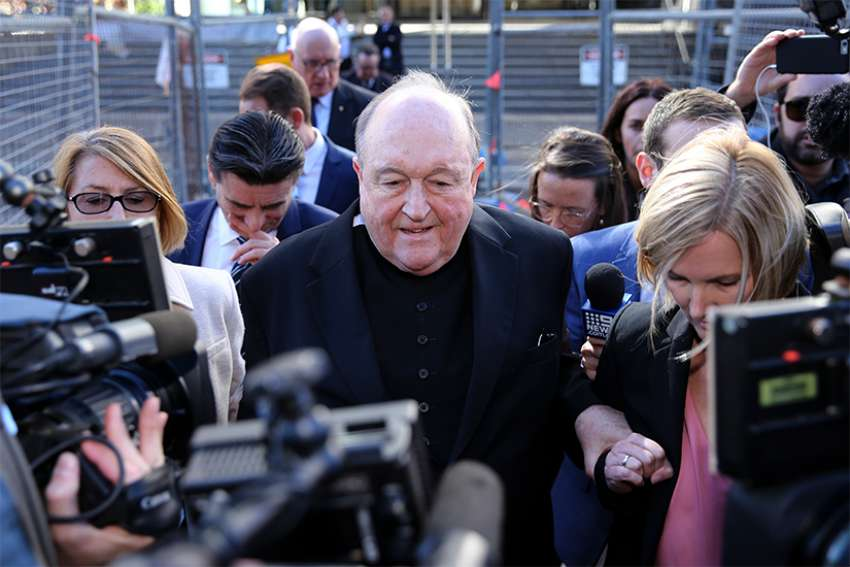 Archbishop Philip Wilson of Adelaide, Australia, leaves the Newcastle Local Court May 22. Archbishop Wilson, who was convicted of covering up clergy sexual abuse, says he will consult his lawyer before he decides next steps.