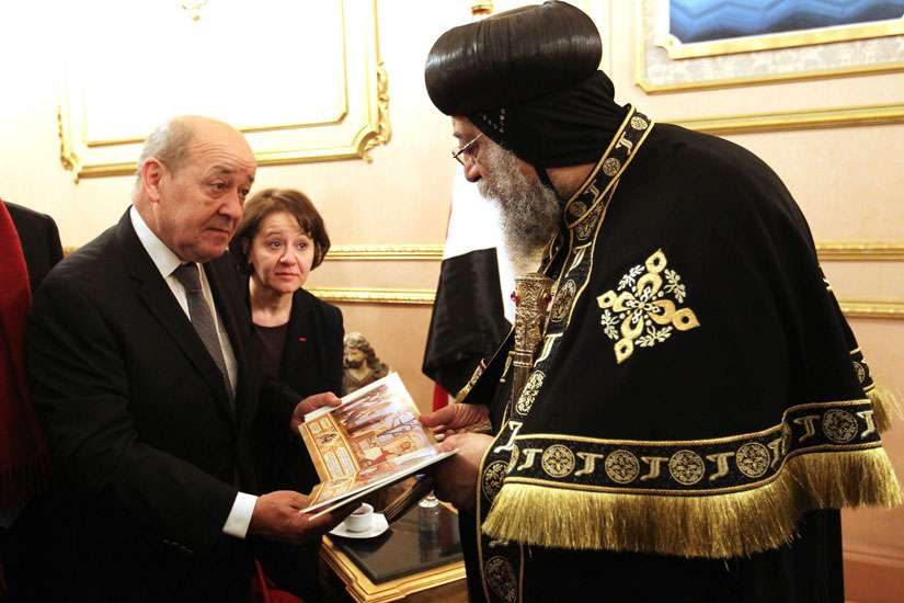 French Defence Minister Jean-Yves Le Drian offers his condolences to Pope Tawadros II of Alexandria, patriarch of the Coptic Orthodox Church, at the Coptic cathedral in Cairo in late February. Earlier in the month, Islamic State released a video of the killing of Egyptian Christians in Libya.