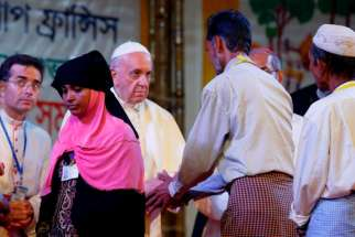 Pope Francis meets Rohingya refugees from Myanmar during an interreligious and ecumenical meeting for peace in the garden of the archbishop's residence in Dhaka, Bangladesh, Dec. 1.