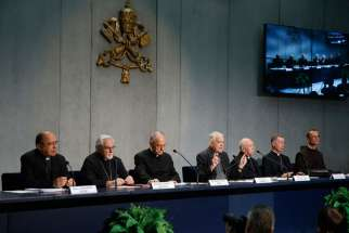Father Federico Lombardi, the Vatican spokesman, gestures at a press conference for the release of Pope Francis' documents concerning changes to marriage annulments at the Vatican Sept. 8. Pope Francis approved rewriting sections of the Latin-rite Code of Canon Law and the Code of Canons of the Eastern Churches to make the annulment process quicker, less expensive and more pastoral.
