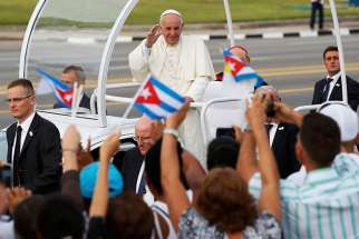 Pope Francis waves to the crowd as he arrives to celebrate Mass in Revolution Square in Havana Sept. 20.