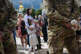 Relatives and friends attend an allegiance ceremony of a Ukrainian army battalion in Kiev before they depart to eastern Ukraine June 23. The Ukrainian Catholic Church welcomed government plans to restore military chaplains to boost soldiers' morale in th e struggle with pro-Russia rebels in eastern Ukraine.