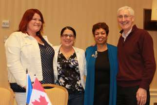 From left, Chimene Boyce, Tracey FErguson, CWL Toronto president Ann D'Souza and Deacon Robert Kinghorn.
