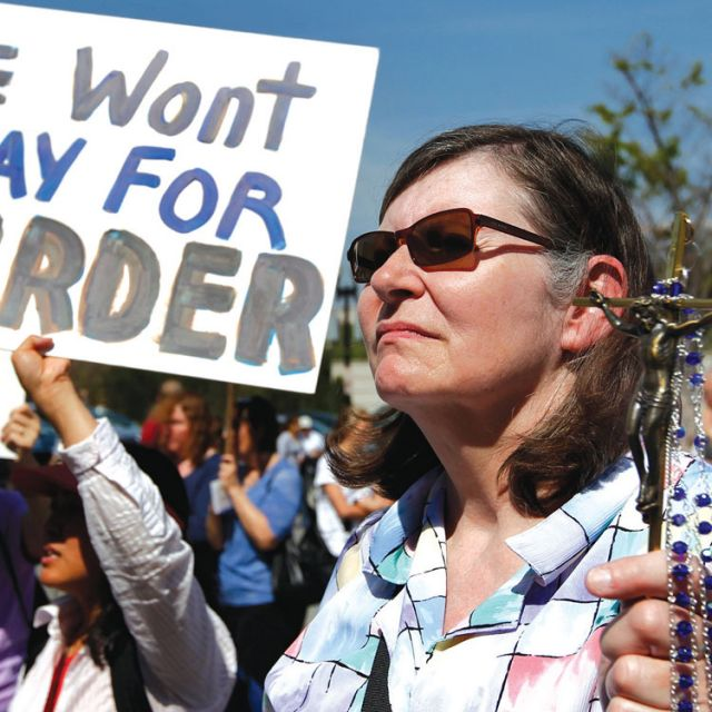 Jeanne Mollen of Falls Church, Va., protests outside the Department of Health and Human Services March 23, 2012, in Washington. The rally was held to oppose the HHS mandate, which forces Catholic institutions to support contraception and abortion services in health insurance plans.