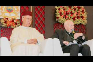 Cardinal Theodore E. McCarrick, retired archbishop of Washington, speaks alongside Sheik Abdallah Bin Bayyah during the Marrakesh conference on the rights of religious minorities in the Muslim world, in Morocco Jan. 27.