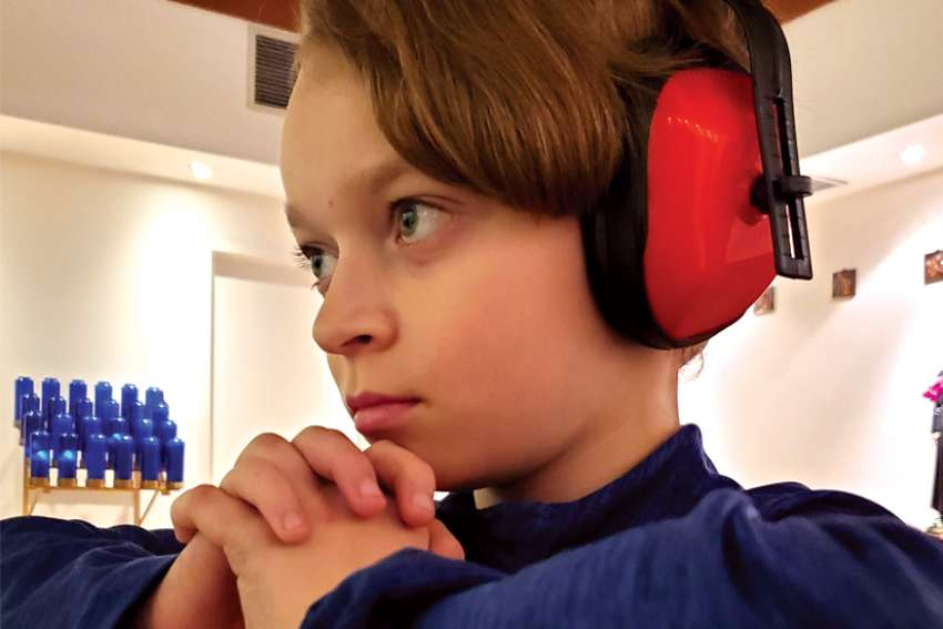 Debbie Frey's son Dallas uses headphones to help deal with his sensory processing disorder.