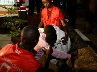 Kenya Red Cross staff members console relatives of the civilians killed in an attack at the Bisharo lodging by Islamist militants from the Somali group al-Shabab in Mandera, at the Chiromo mortuary in Kenya's capital, Nairobi, on Oct. 25, 2016.