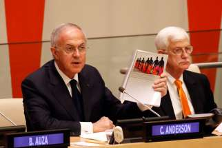 Supreme Knight Carl A. Anderson speaks during a conference addressing the persecution of Christians and other minorities in the Middle East and Africa at the United Nations April 28. Looking on is Thomas Farr, director of the Religious Freedom Project at Georgetown University. The Vatican mission to the U.N. was a co-sponsor of the conference.