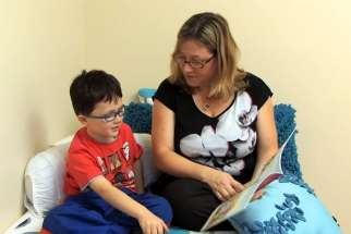 Strategies like asking open-ended questions promotes discussion and new vocabulary in children, according to Andrea Coke, the school board's chief language pathologist. A parent is shown discussing the book with her child in this screenshot of a board resource video.
