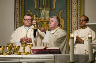 Toronto's Auxiliary Bishop William McGrattan (centre), who becomes bishop of Peterborough on June 23, celebrated his own farewell Mass at St. Paul's Basilica on June 20.