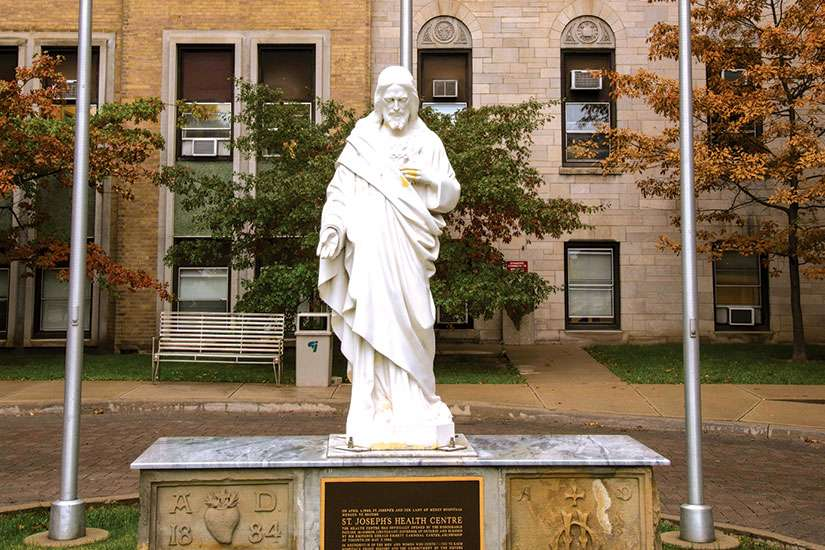 The statue of Jesus outside St. Joseph's Health Centre is remaining right where it is, despite rumours to the contrary.