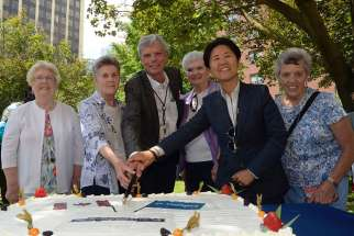 From left, Sr. Ann Delaney, Sr. Thérèse Meunier, St. Michael's Hospital president Dr. Bob Howard, Sr. Mary Anne McCarthy, city councillor Kristyn Wong-Tam and Sr. Georgette Gregory cut the cake at the hospital's 125th birthday celebration.   Although the Sisters of St. Joseph are no longer in control of St. Michael's Hospital, their legacy lives on at the downtown Toronto hospital.