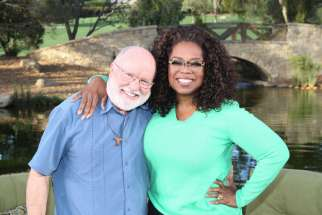 "Franciscan Father Richard Rohr poses for a photo with Oprah Winfrey on the set of ""Super Soul Sunday"" during the taping of the show Nov. 12, 2014. The show runs on OWN, the Oprah Winfrey Network, Sunday, Feb. 8, 11 a.m. ET. Father Rohr will be the first Catholic priest to appear on ""Super Soul Sunday"" since the series debuted in fall 2011, 101 episodes ago."