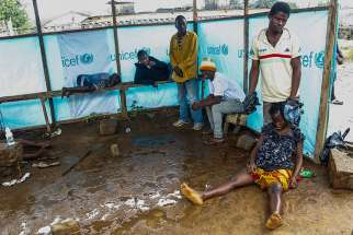 Liberians wait outside the John F. Kennedy Ebola treatment center in Monrovia, Liberia, Sept. 18. Pope Francis called for prayers and concrete help for the thousands of people affected by the deadly Ebola virus.