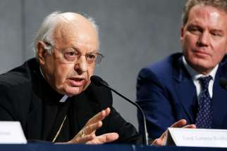 Cardinal Lorenzo Baldisseri, secretary-general of the Synod of Bishops, speaks during a Sept. 18 Vatican news conference to announce synod changes. Also pictured is Greg Burke, Vatican spokesman. Pope Francis has issued an apostolic constitution, updating the rules of how the synod is prepared for, conducted and implemented.