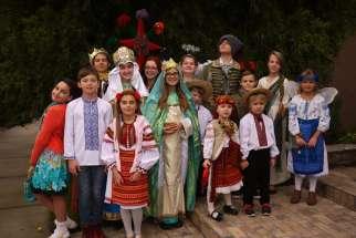 Children who perform in the Ukrainian Christmas play, vertep, pose for a photo Dec. 11 in Sacramento, Calif.