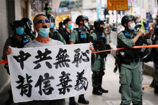 "A man holding a banner reading ""Chinese communist party is shameless, break the promises,"" shouts during a protest against the new national security law in Hong Kong July 1, 2020."