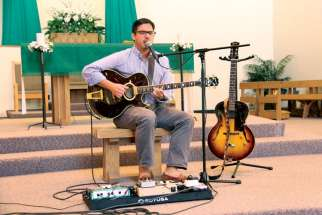 UBC assistant professor Samuel Rocha performing at St. Joseph the Worker Church in Vancouver. His new album reflects the impact Saint Augustine has had on his life.
