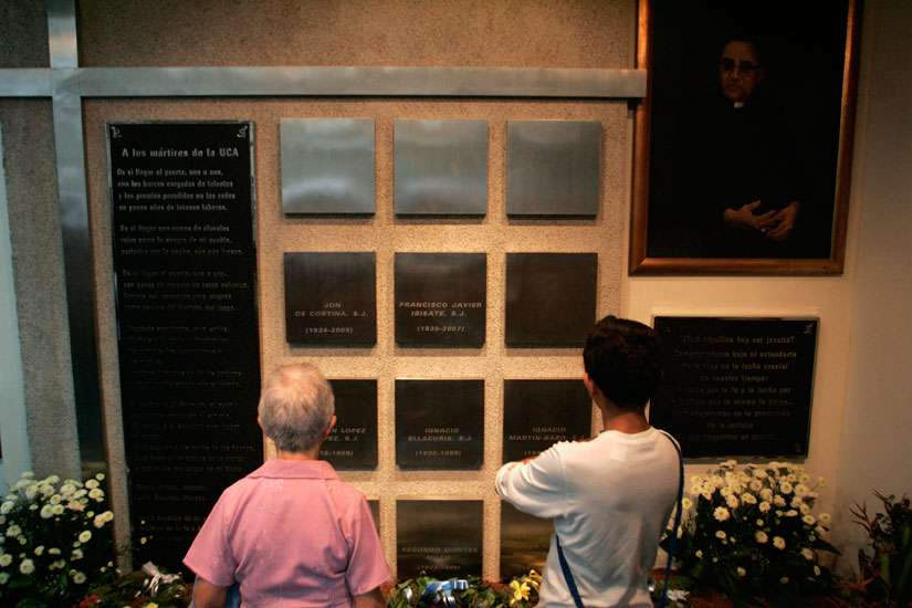 Visitors look at the names of six Jesuits killed during El Salvador's civil war in the chapel of Central American University in San Salvador. The priests, their housekeeper and her daughter were killed Nov. 16, 1989.
