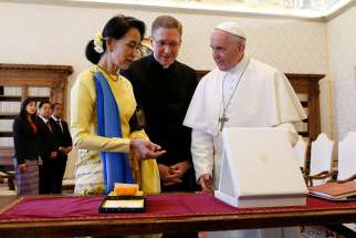 Pope Francis exchanges gifts with Aung San Suu Kyi, leader of Myanmar, during a private audience at the Vatican May 4.
