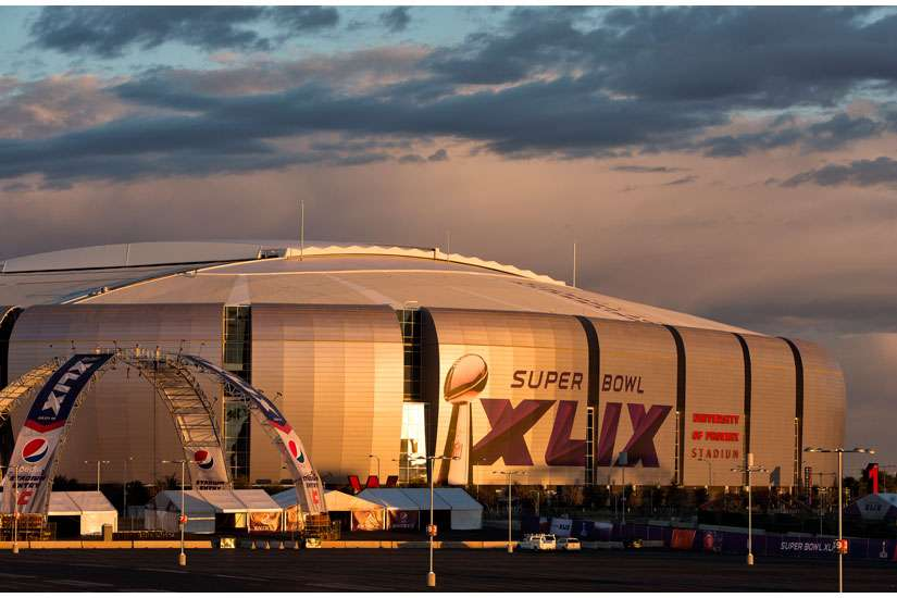 University of Phoenix Stadium in Glendale, Ariz., seen Jan. 21, is readied for Super Bowl XLIX, the Feb. 1 match between the Seattle Seahawks and the New England Patriots. Catholic Charities of Arizona is preparing to serve an increased number of sex-tra fficking victims arrested by local police in the days surrounding Super Bowl Sunday.
