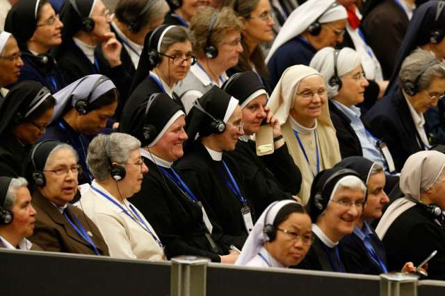 The heads of women's religious orders attend an audience with Pope Francis in Paul VI hall at the Vatican May 12. During a question-and-answer session with members of the International Union of Superiors General, the pope indicated his willingness to establish a commission to study whether women could serve as deacons.