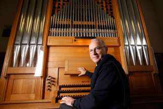 Msgr. Vincenzo De Gregorio, director of the Pontifical Institute of Sacred Music, is pictured at an organ at the institute in Rome Dec. 6. Msgr. De Gregorio said the Catholic Church tries to make music accessible to the congregation so everyone can participate.
