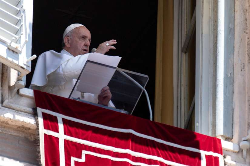 Pope Francis gives a blessing as he leads the Angelus from the window of his studio overlooking St. Peter's Square at the Vatican June 30, 2019.