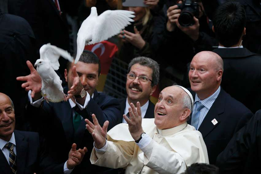 Pope Francis releases doves, a traditional sign of peace, prior to celebrating Mass in 2014 at the Cathedral of the Holy Spirit in Istanbul.