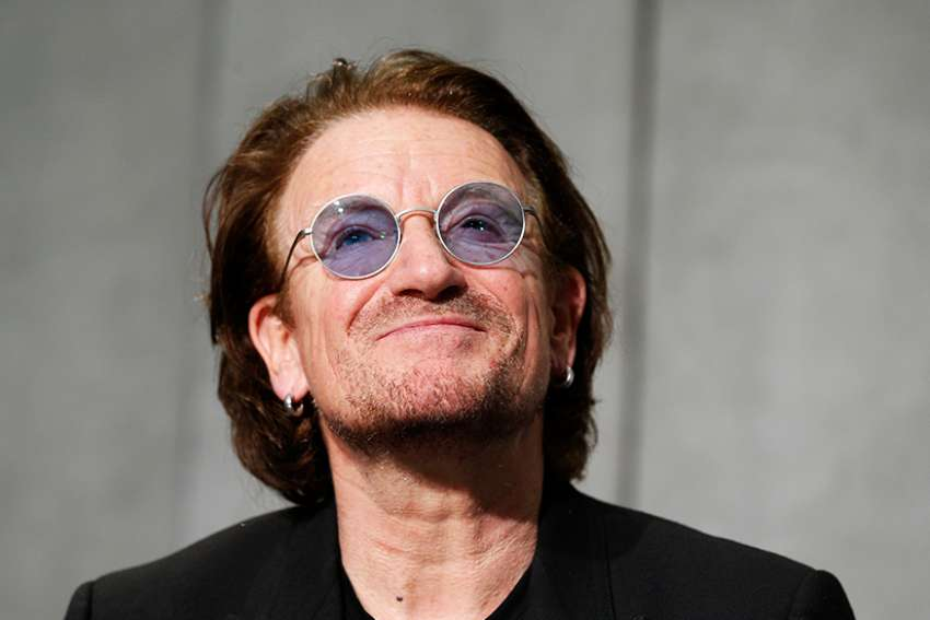 Bono, the lead singer of U2, speaks during a news conference in the Vatican press hall after meeting Pope Francis at the Vatican Sept. 19.