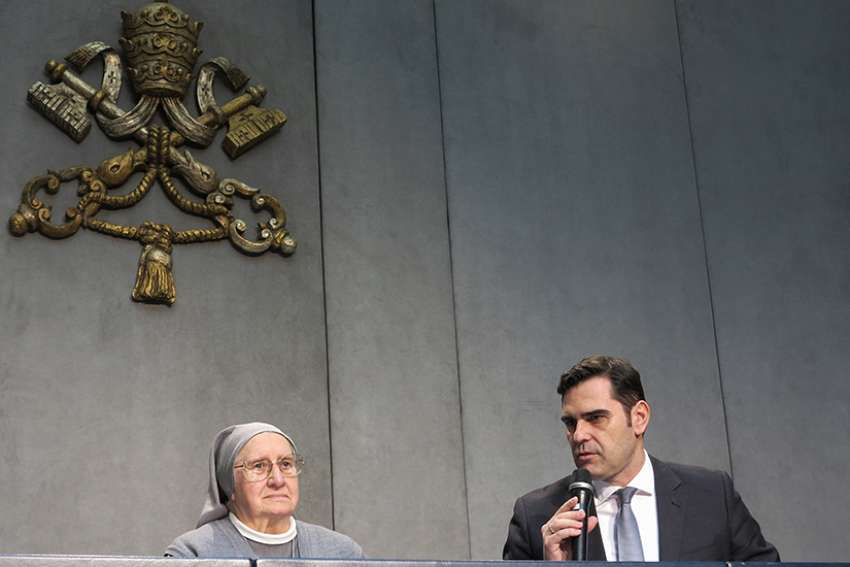 Alessandro Gisotti, interim director of the Vatican press office, introduces Consolata Sister Eugenia Bonetti at a Vatican news conference April 17, 2019. Sister Bonetti has led a major international effort by religious orders to fight human trafficking and help women and girls rebuild their lives after they were tricked by traffickers into prostitution. She was asked to write the meditations for this year's Way of the Cross at Rome's Colosseum.