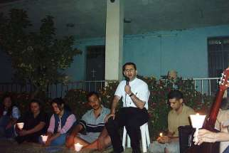 Father Ragheed Aziz Ganni, who was killed for the faith June 3, 2007 in Mosul, is seen with a group of young adults