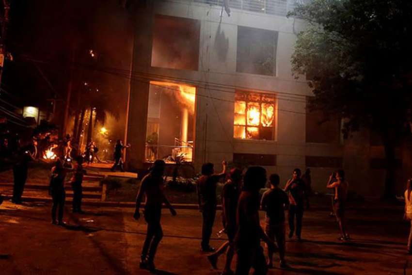 Bishops of Paraguay is calling for peace after demonstrators set fire to the country's Congressional building in Asuncion March 31.