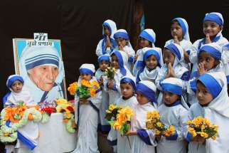 Girls dressed up as Blessed Mother Teresa during an Aug. 26 event to commemorate her 104th birth anniversary in a school in Bhopal, India. Mother Teresa was born Agnes Gonxha Bojaxhiu Aug. 26, 1910, to Albanian parents in Skopje, in present-day Macedonia . She died in 1997 and was beatified by Pope John Paul II in 2003.
