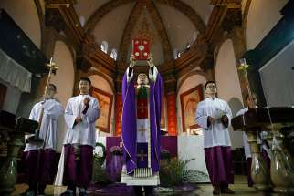 A priest celebrates Mass Dec. 4, 2016 in the Cathedral of the Immaculate Conception in Beijing.