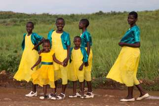 Girls are seen walking near Kisumu, Kenya, in this 2017 file photo. Catholic doctors in Kenya have warned against a mass cervical cancer vaccination program for young girls, as the government accelerates plans to roll out the program in September.