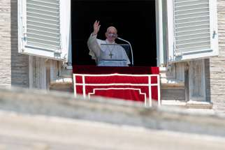 Pope Francis speaks from a window at the Vatican overlooking St. Peter's Square during the Angelus July 19, 2020. The pope expressed his concerns about increased tensions at the Armenia-Azerbaijan border.