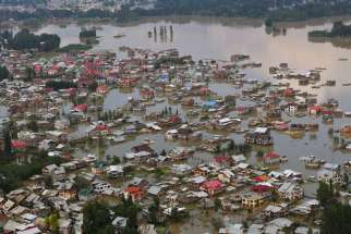 This aerial view taken Sept. 10 shows houses submerged by floodwater in Srinagar, India. While nearly 250 people have perished in the floods following rains in the Kashmir Valley in the foothills of the Himalayas, more than 700,000 people have been maroo ned on rooftops, trees and hills since Sept. 7.